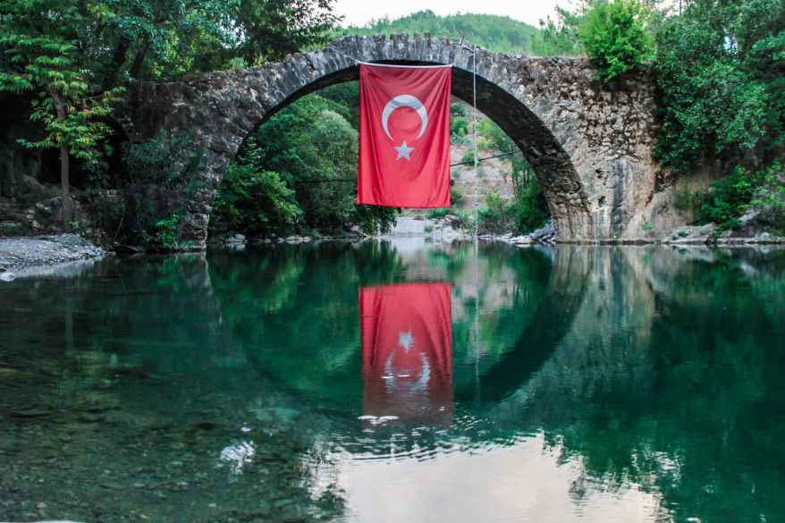 turkey flag hanging on bridge