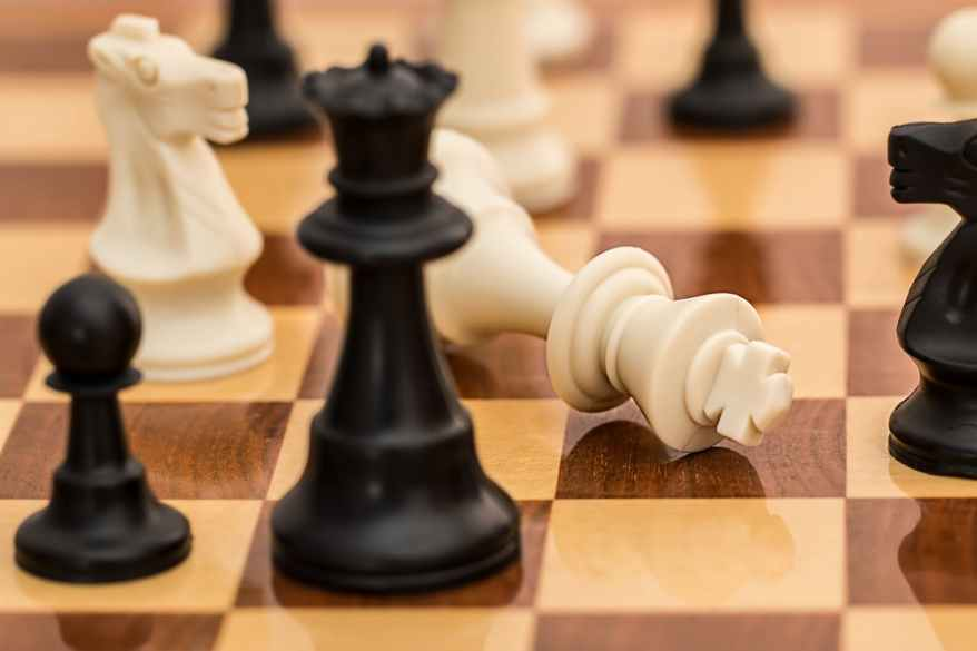 black white and brown chess board game