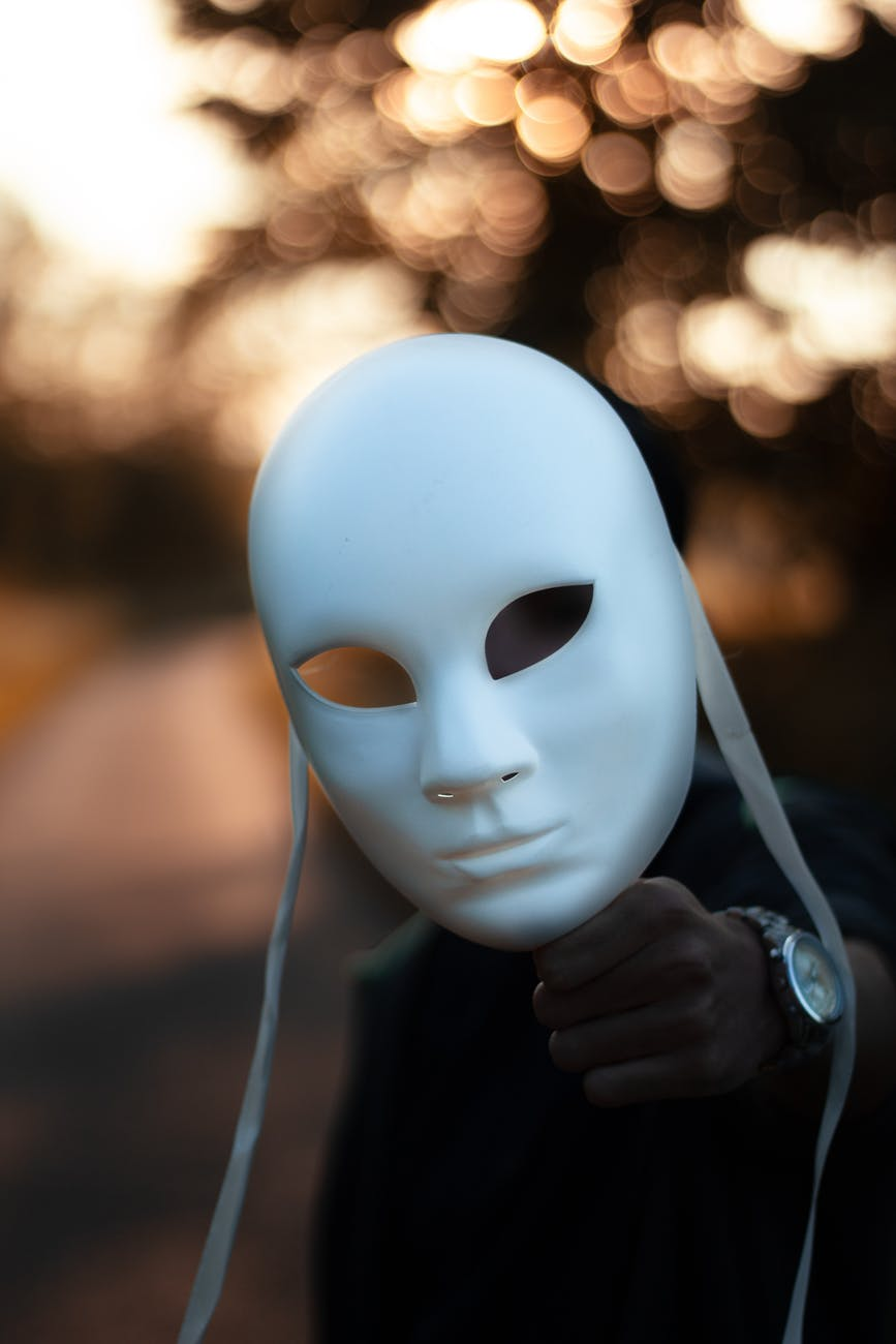 focus photography of white mask