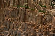 Large hexagonal columns of volcanic rock are pictured on Ninepin Group, also known as Kwo Chau Islands, southeast of Hong Kong August 30, 2012. An ancient supervolcano that last erupted 140 million years ago, considered as one of the oldest supervolcanos, has been discovered in the southeastern part of Hong Kong, the Hong Kong Geological Survey under the government's Civil Engineering and Development Department said on Thursday. It added that this is the first discovery of an ancient supervolcano in southeastern China. REUTERS/Bobby Yip (CHINA - Tags: ENVIRONMENT SOCIETY)