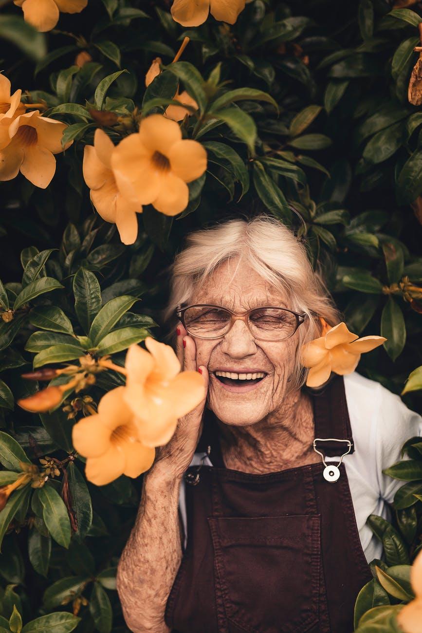 woman standing near yellow petaled flower