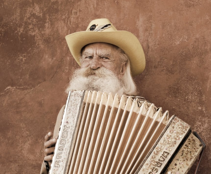 adult man playing a musial instrument
