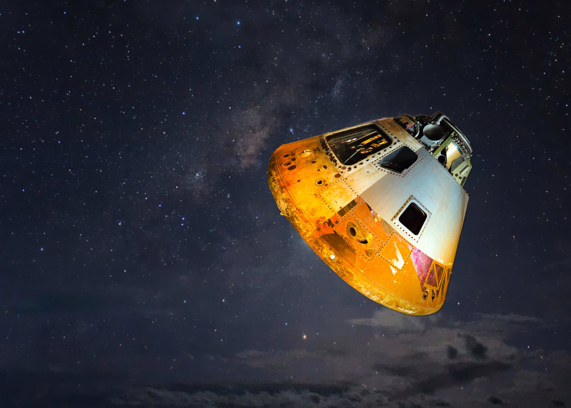 grey and orange spaceship